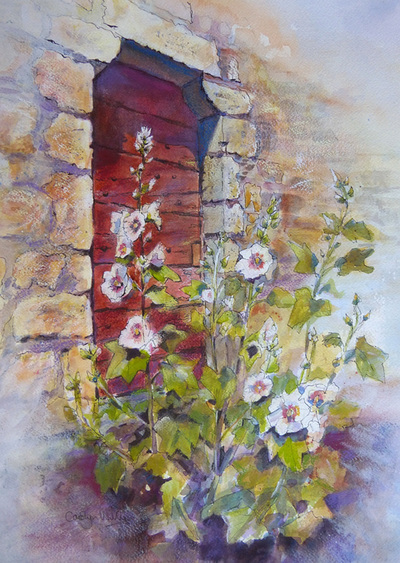 Painting of hollyhocks set against rustic wood and stone wall. Painting by Carolyn Wilson