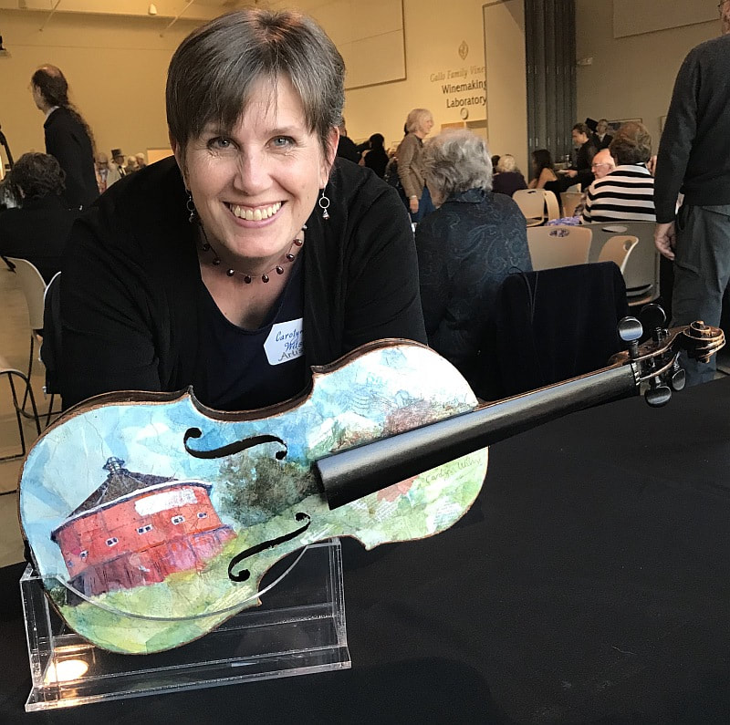 Artist Carolyn Wilson and her painted violin. Sold ar auction for Santa Rosa Symphony Youth Orchestra