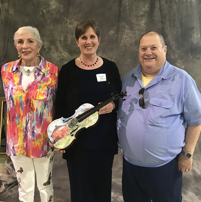 Artist Carolyn Wilson with Alan and Susie Seidenfeld, Santa Rosa Symphony supposrters