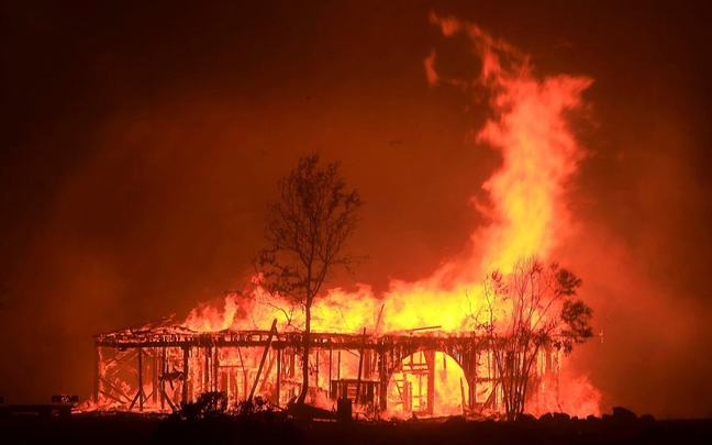 Photo of Fountaingrove Round Barn on fire.